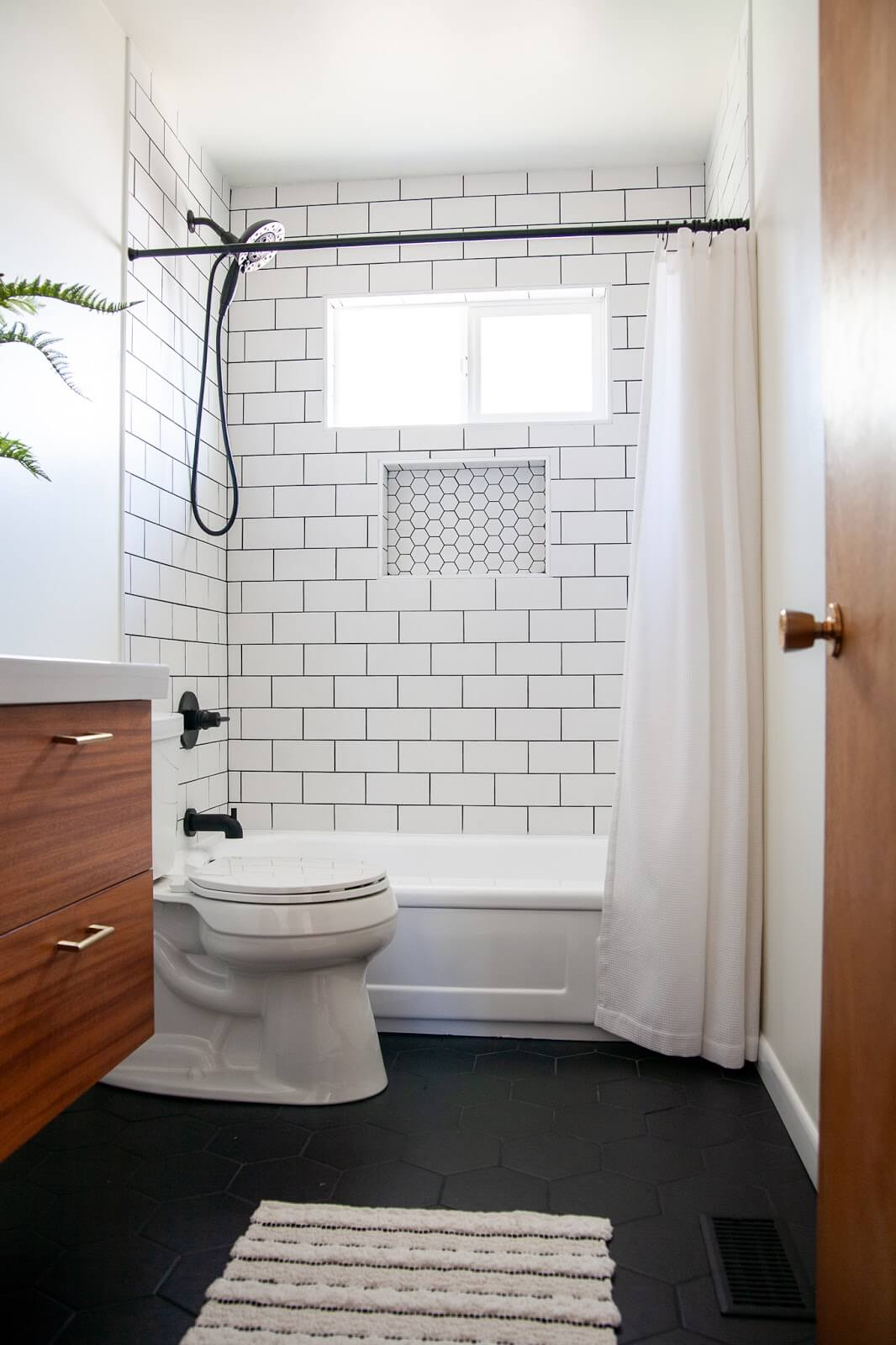 Bold Black Hexagon Tile Bathroom Flooring Design