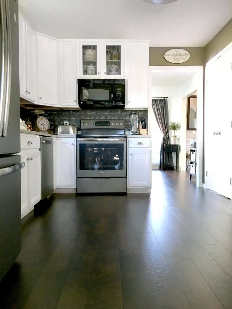 Sleek and Dark Pergo Kitchen Flooring Design Idea