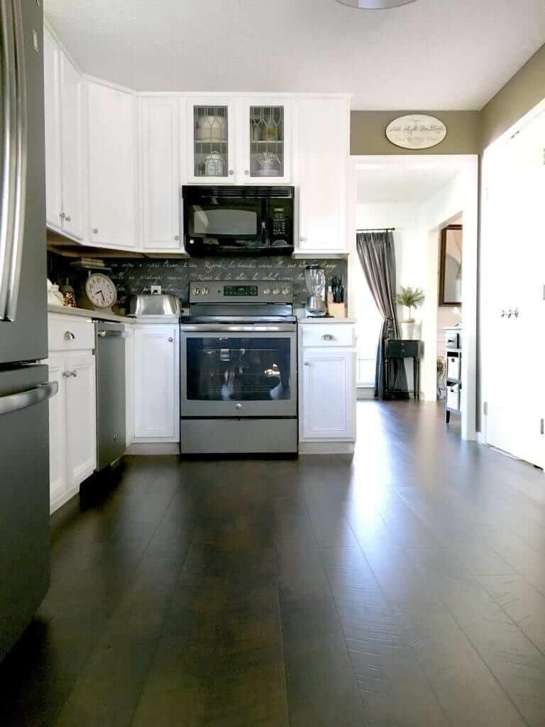 Sleek and Dark Pergo Kitchen Flooring Design Idea