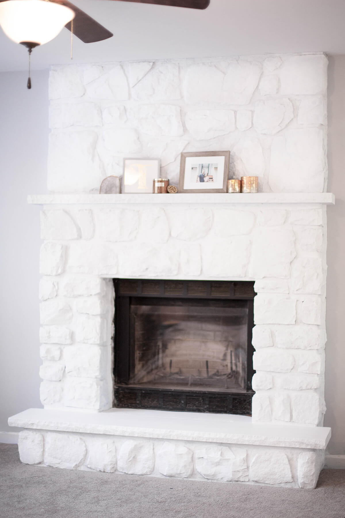 Modern White Stone Fireplace and Hearth Makeover