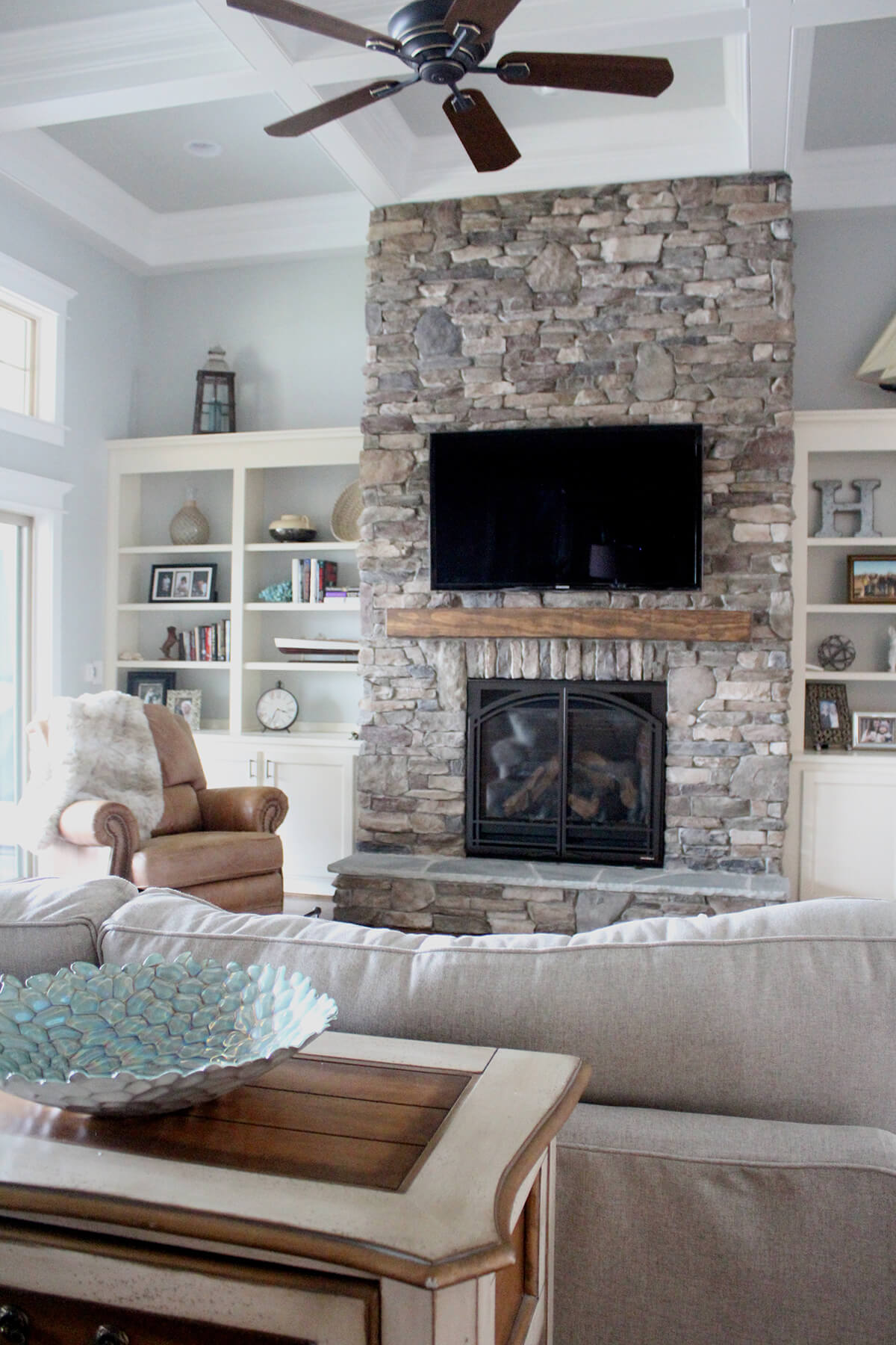 Impressive Rustic Stacked Stone Floor-to-Ceiling Fireplace