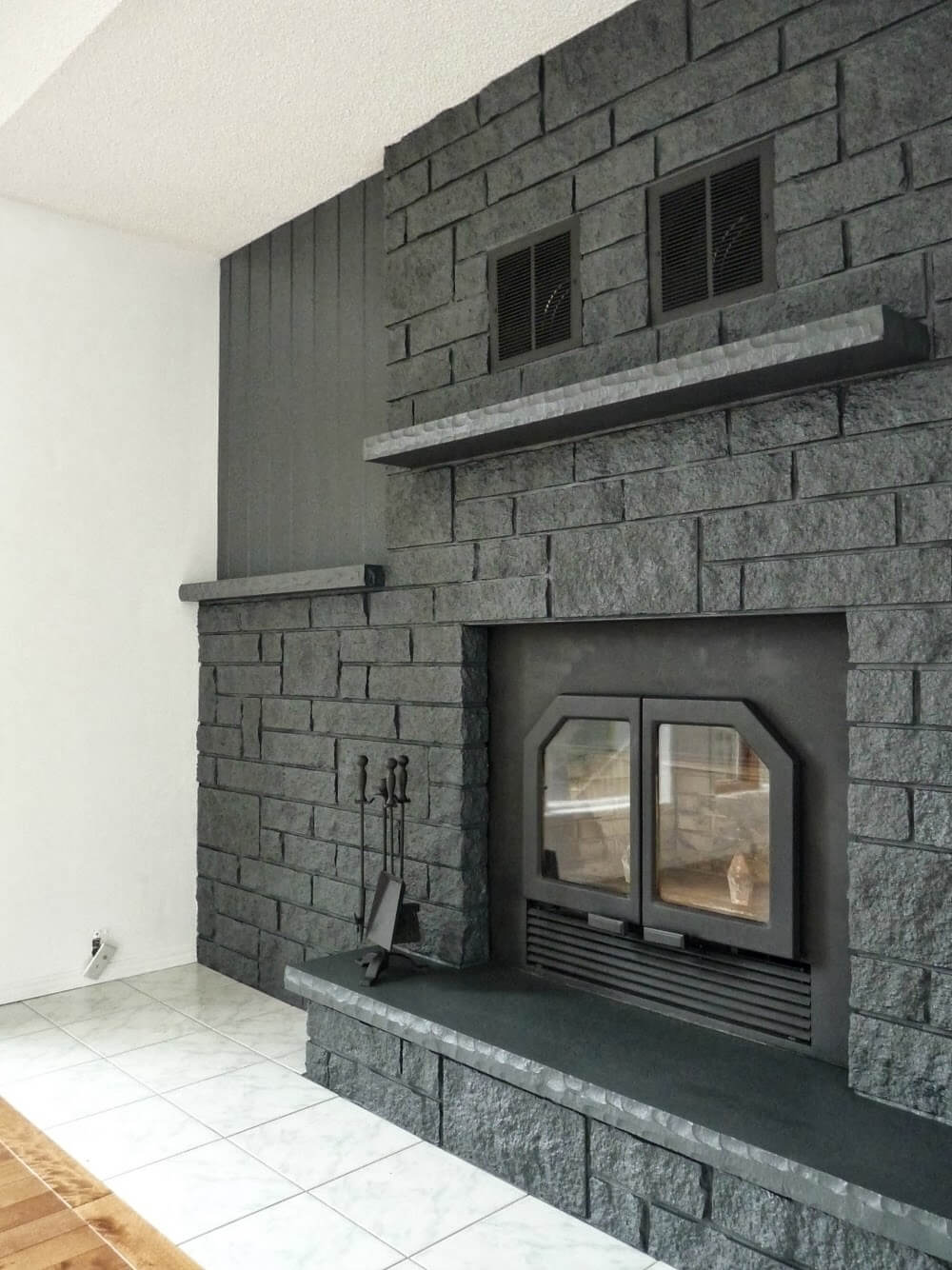 Dramatic Modern Charcoal Gray Fireplace Wall De-Cluttering