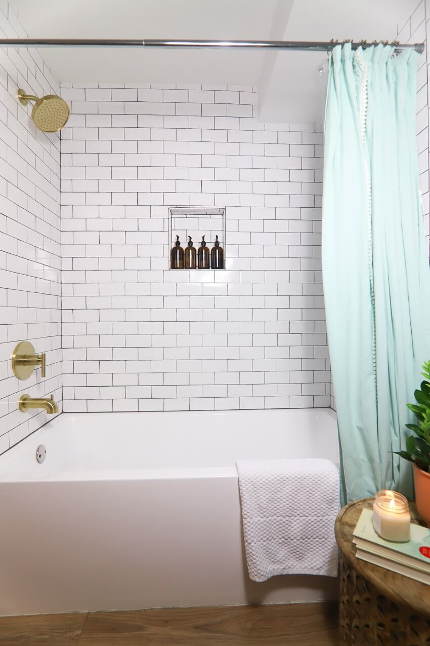 Subway Tile, Gold Fixtures, and Wood Floors