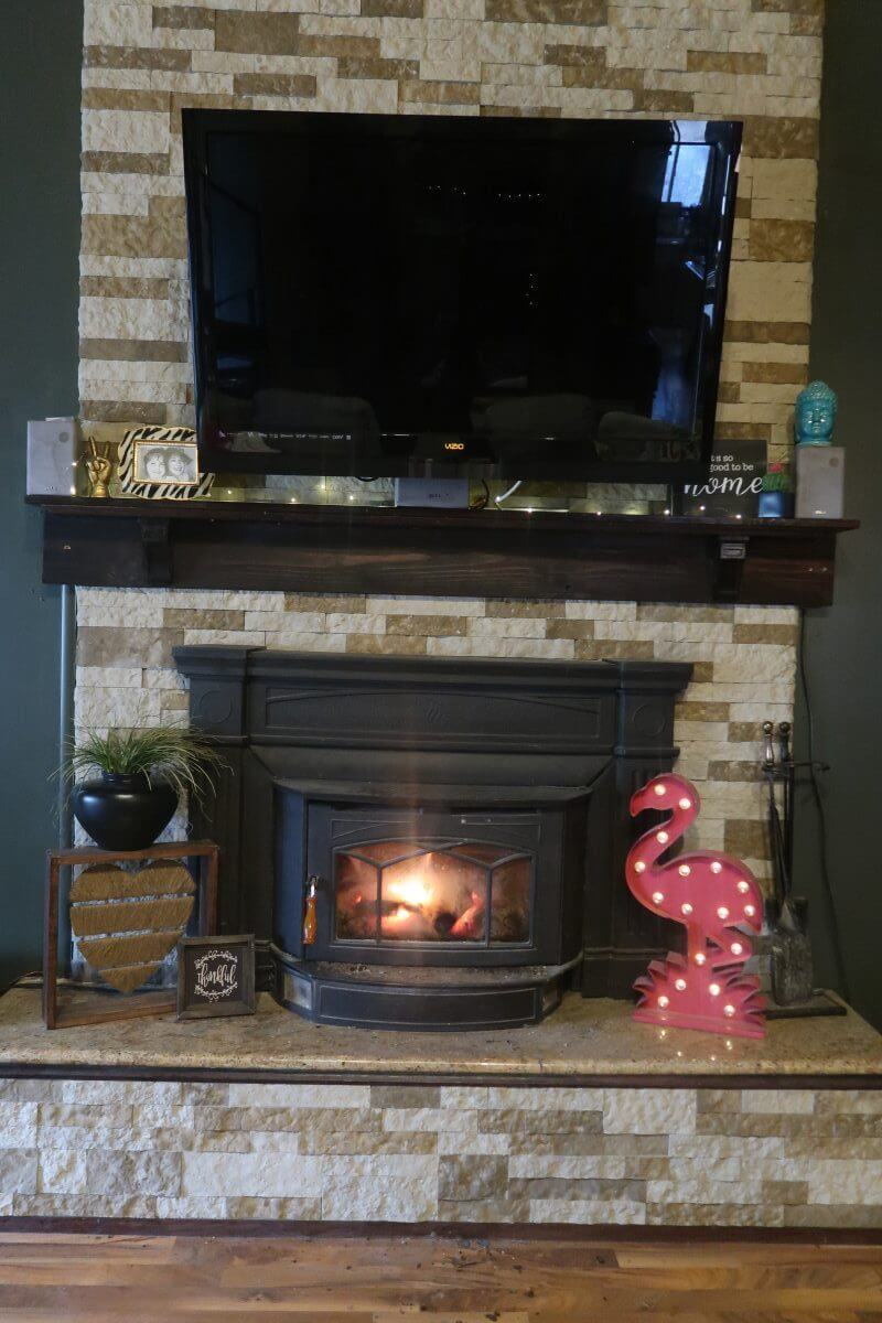 Multicolored Floor to Ceiling Airstone Fireplace Renovation