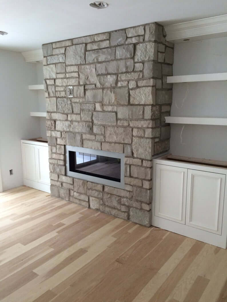 Shelves with Perfect Lighting to Frame Your Fireplace