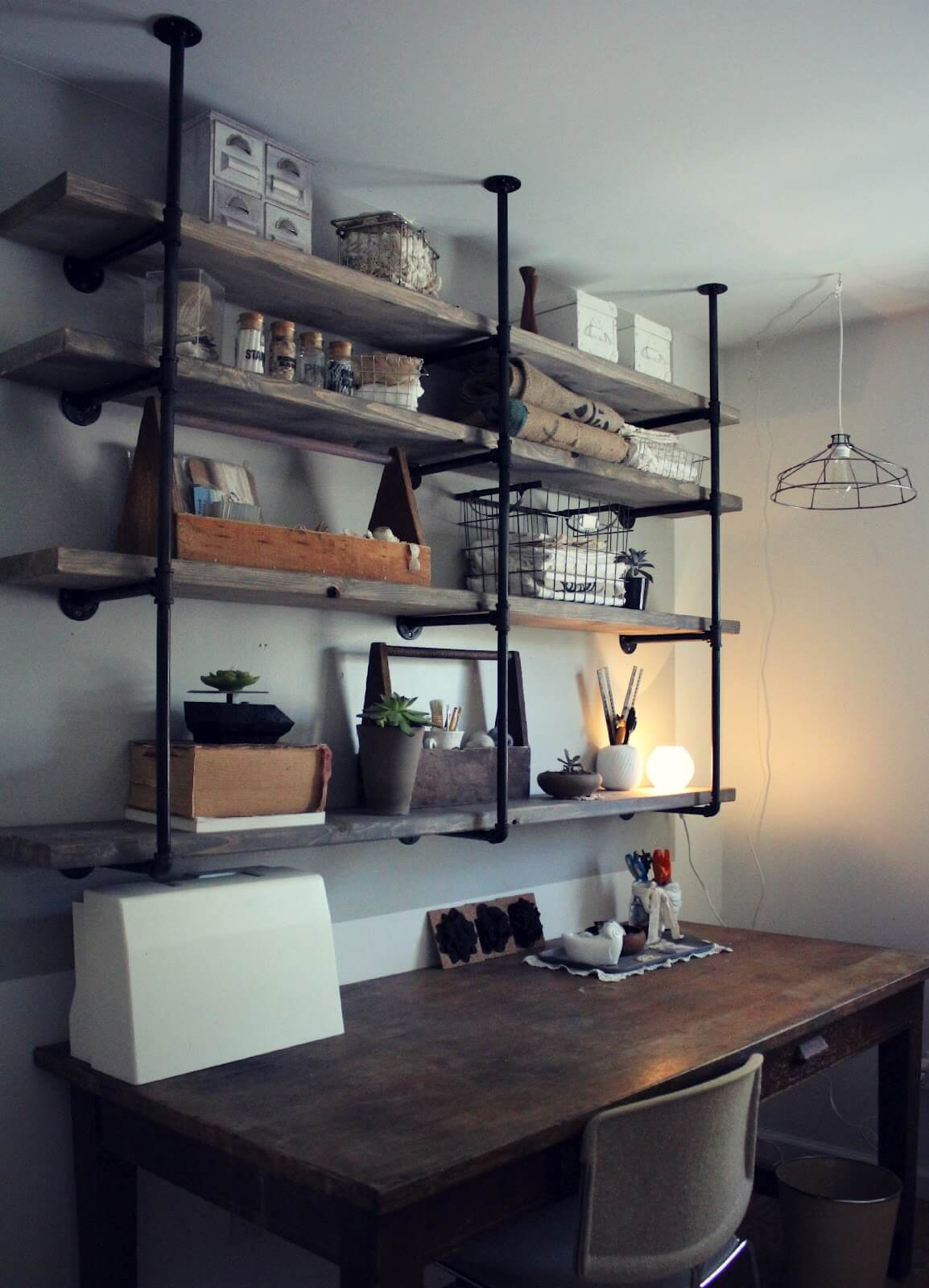Rustic Ceiling-Mounted Wood and Pipe Craft Shelves