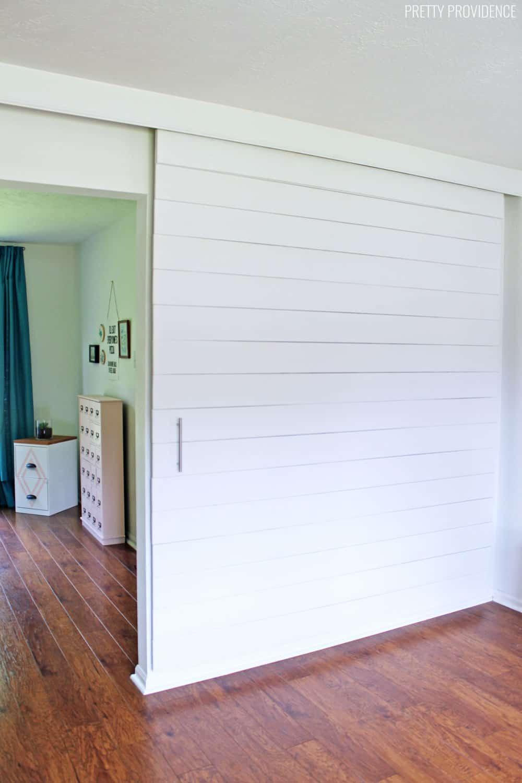 Sliding White Shiplap Barn Door Divider Wall