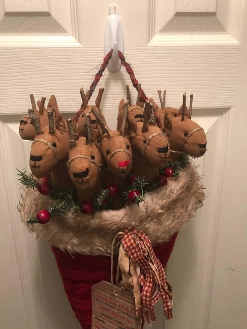 Primitive Reindeer Nestled Inside a Santa Hat
