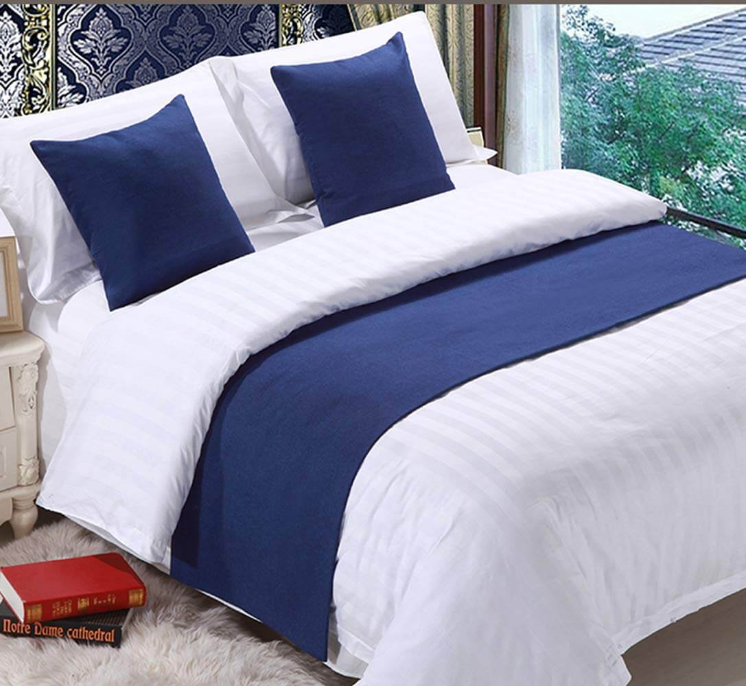 Navy Damask Wallpaper with Luxurious Bedding