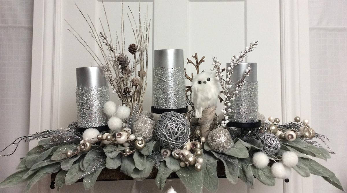 Silver Woodland Candles on Poinsettia Leaves