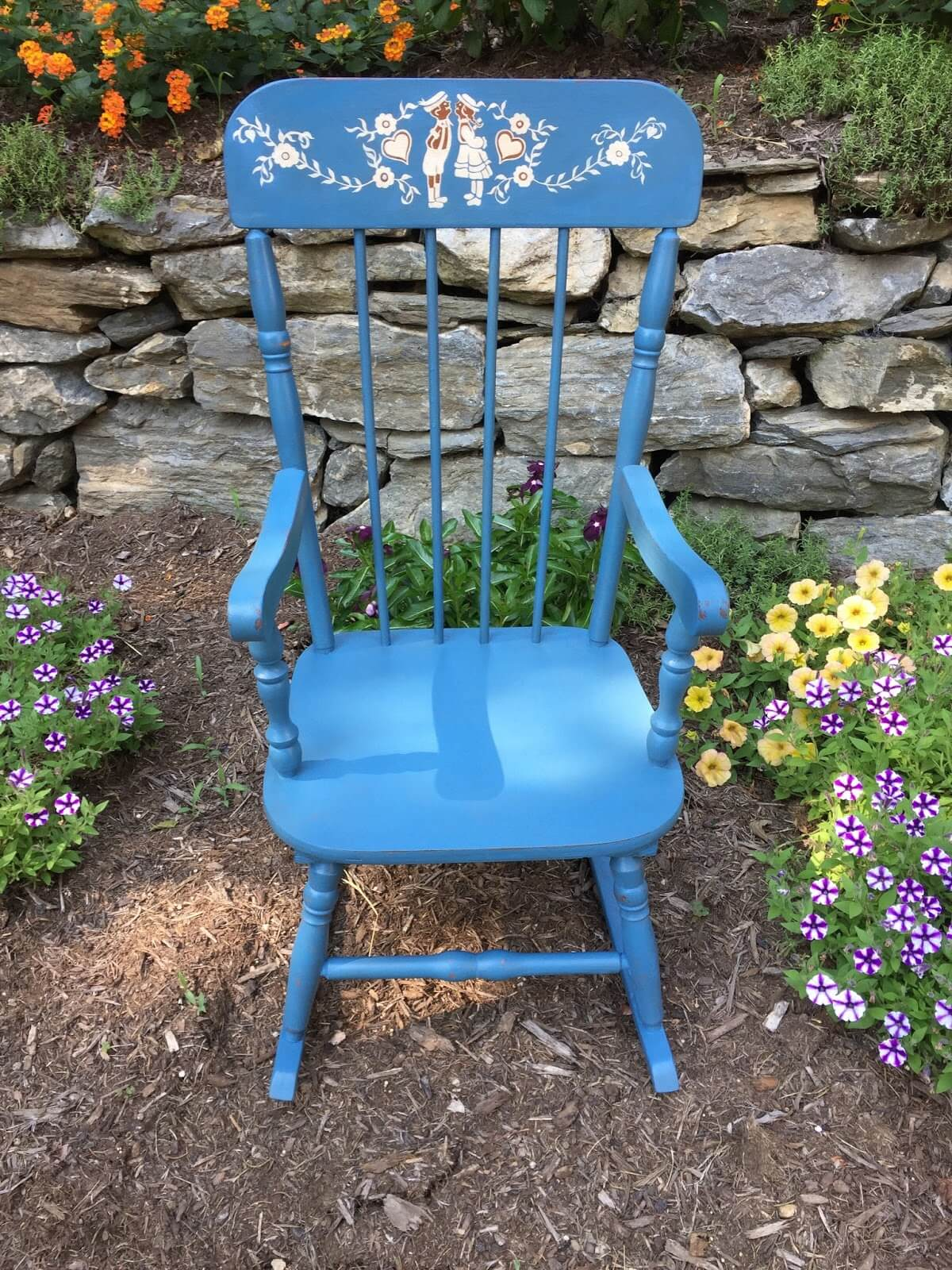 An Adorable Rocking Chair Painted Using Stencils