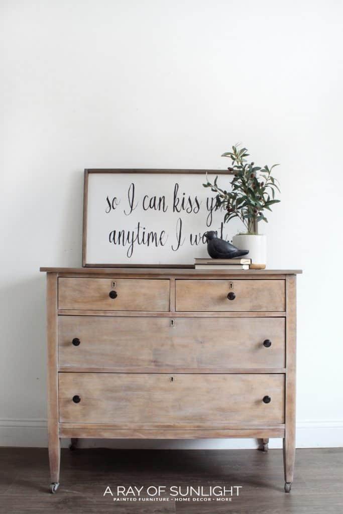 Simple Arrangement of Dresser and Artwork