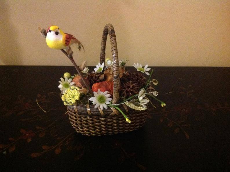 Basket Full of Earthy Plants and Bird on Branch