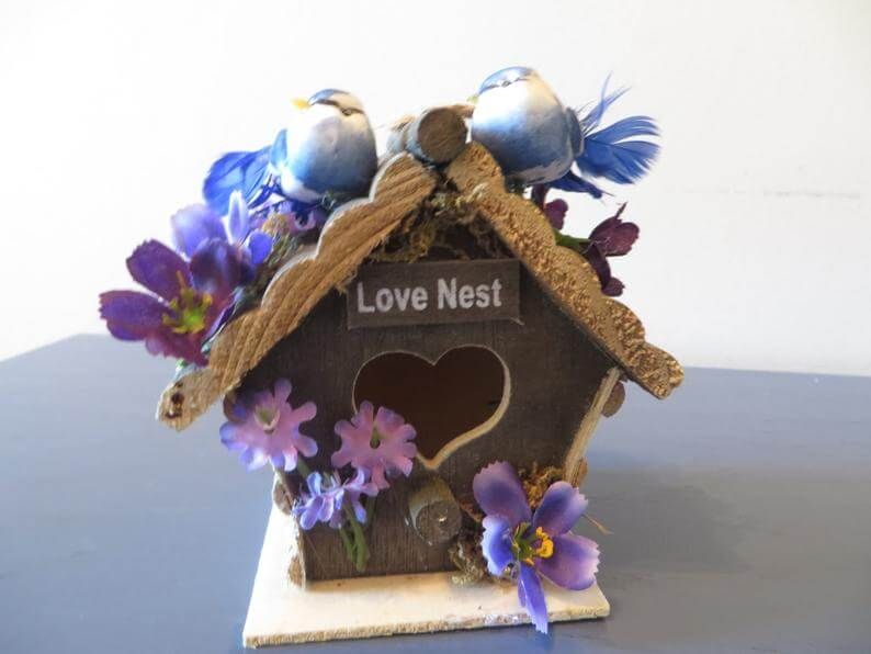 The Love Nest Featuring Two Birds in a Wooden House