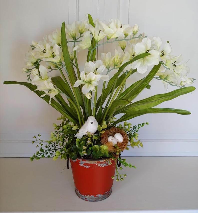Terracotta Pot with Tall Flower Grouping and Bird Nest