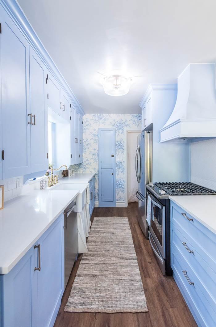 Floor to Ceiling Light Blue Painted Cabinets with Blue and White Toile