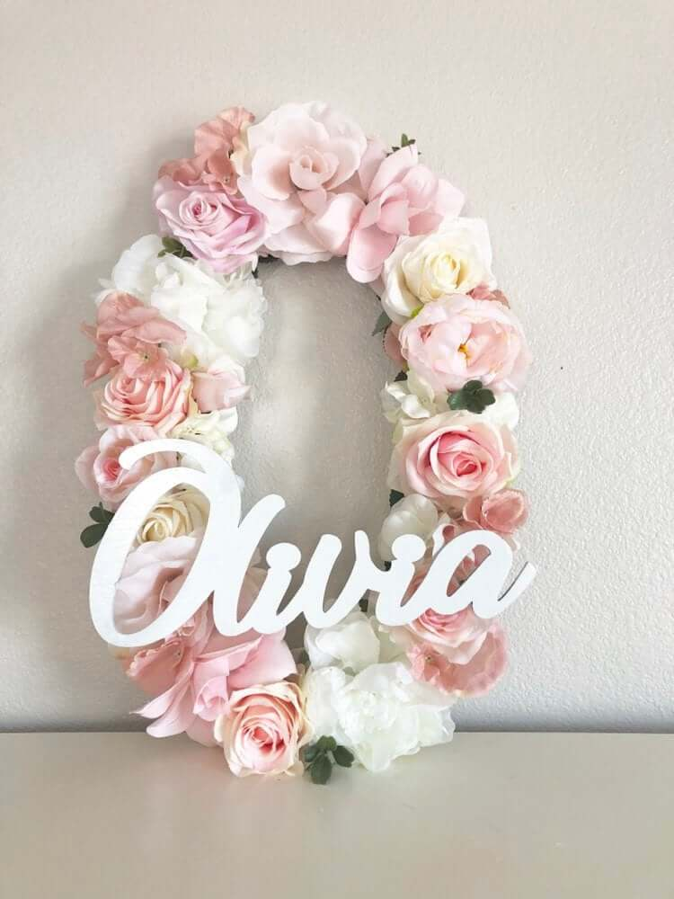 Small Wooden Name Displayed on Large Floral Initial Wall Art