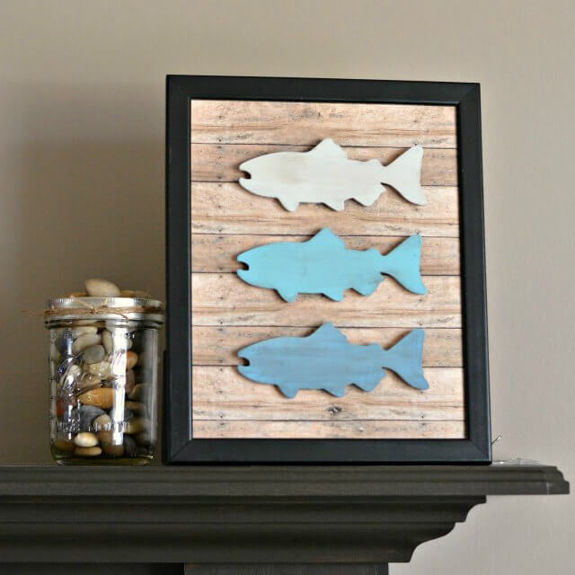 White to Blue Fish Trio on Wood Planks with Black Frame