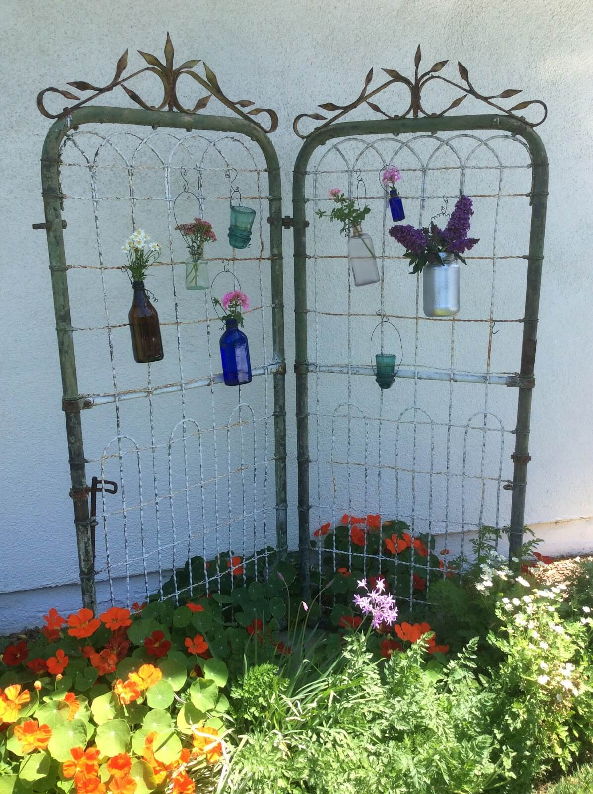 Whimsical Iron Gate with Flower Vases
