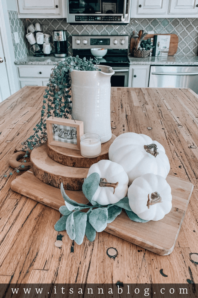 Wooden Circles and Pumpkin Vignette with Greenery