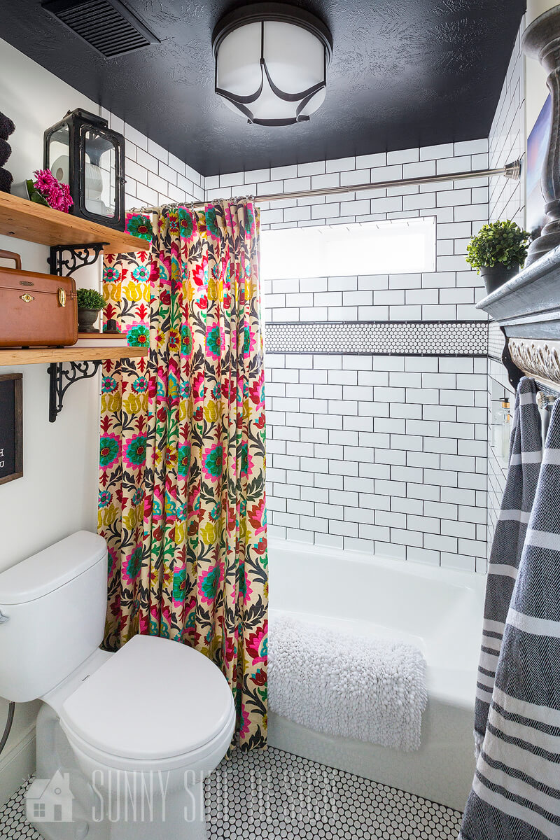 Bold Black Ceiling and Pop of Color Shower Curtain Modern Bathroom