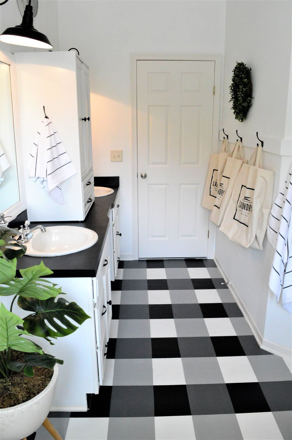 Black, White, and Plaid All Over the Bathroom Floor