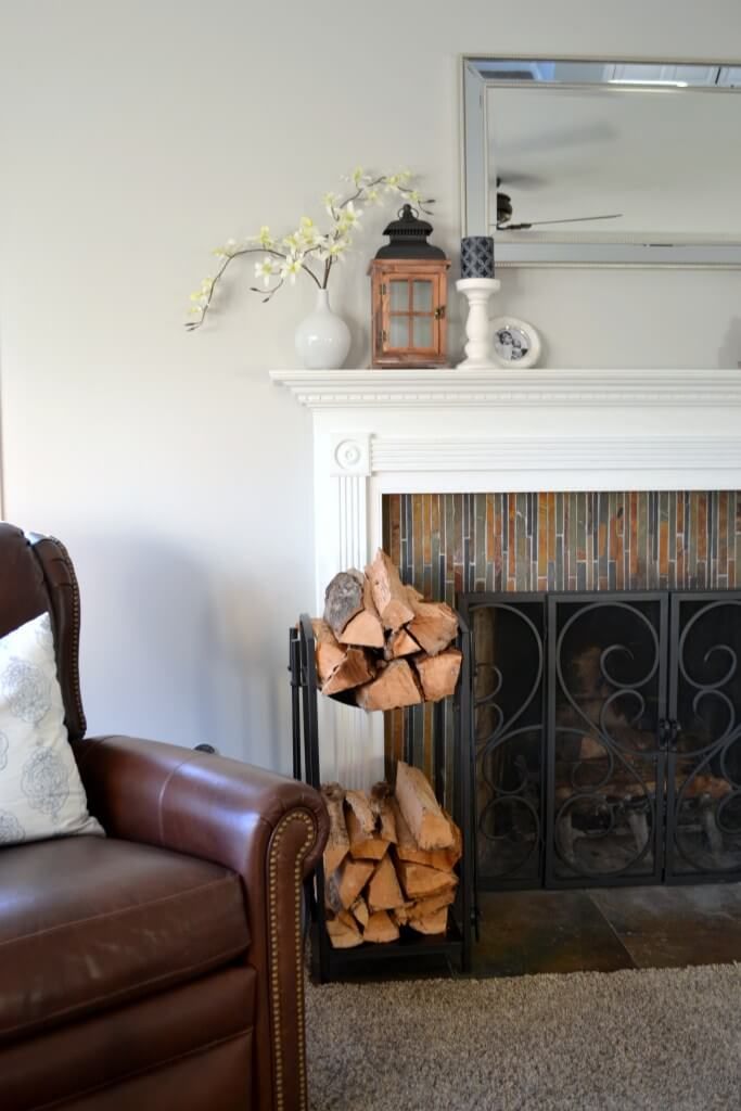 Vertical Multicolored Tile and White Fireplace