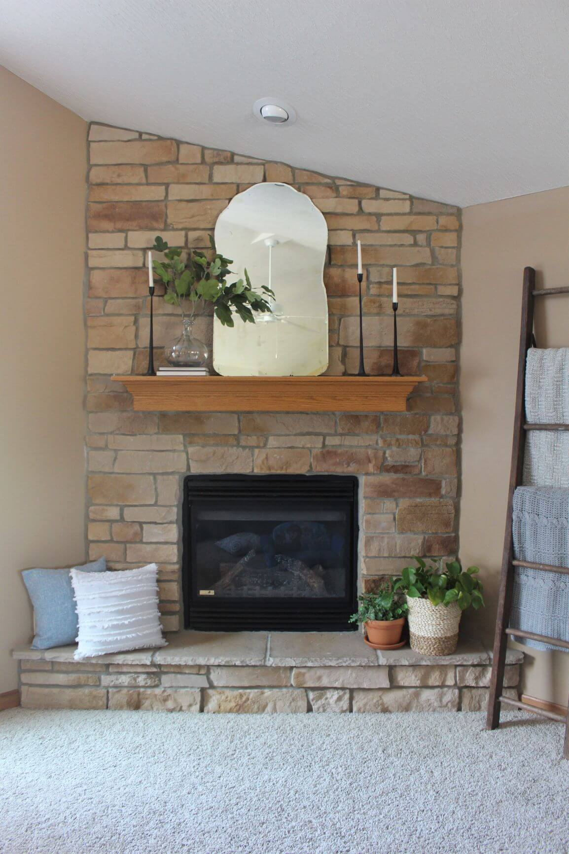 Stunning Stone Facade and Seating Warm Fireplace