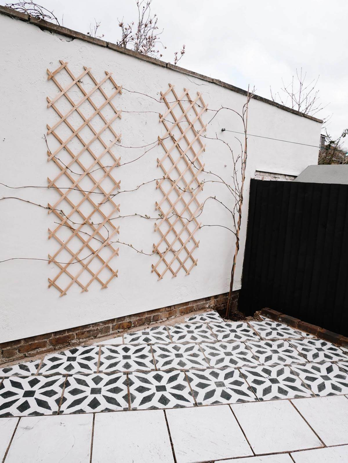 Stenciled Geometric Flowered Black and White Outdoor Tile