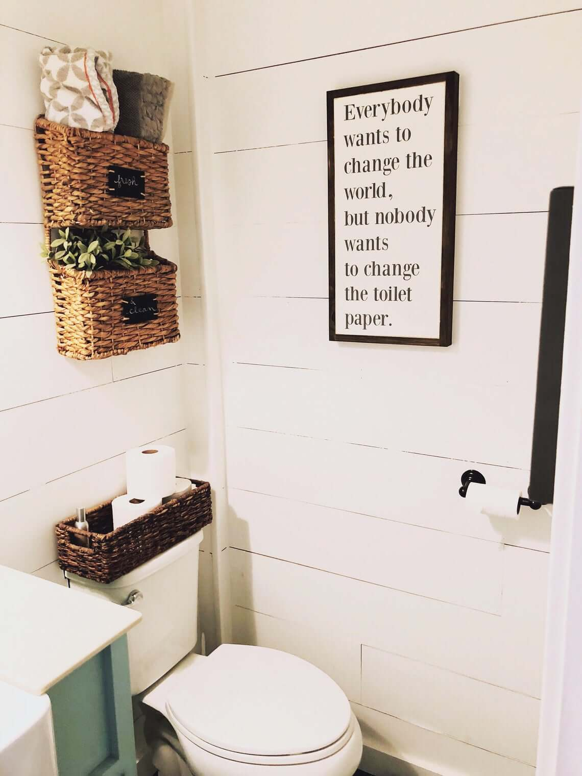 Storage Galore with Woven Baskets and Fun Bathroom Sign