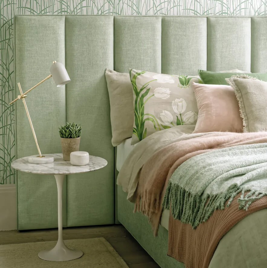 Upholstered Green Headboard and Bamboo Wallpaper