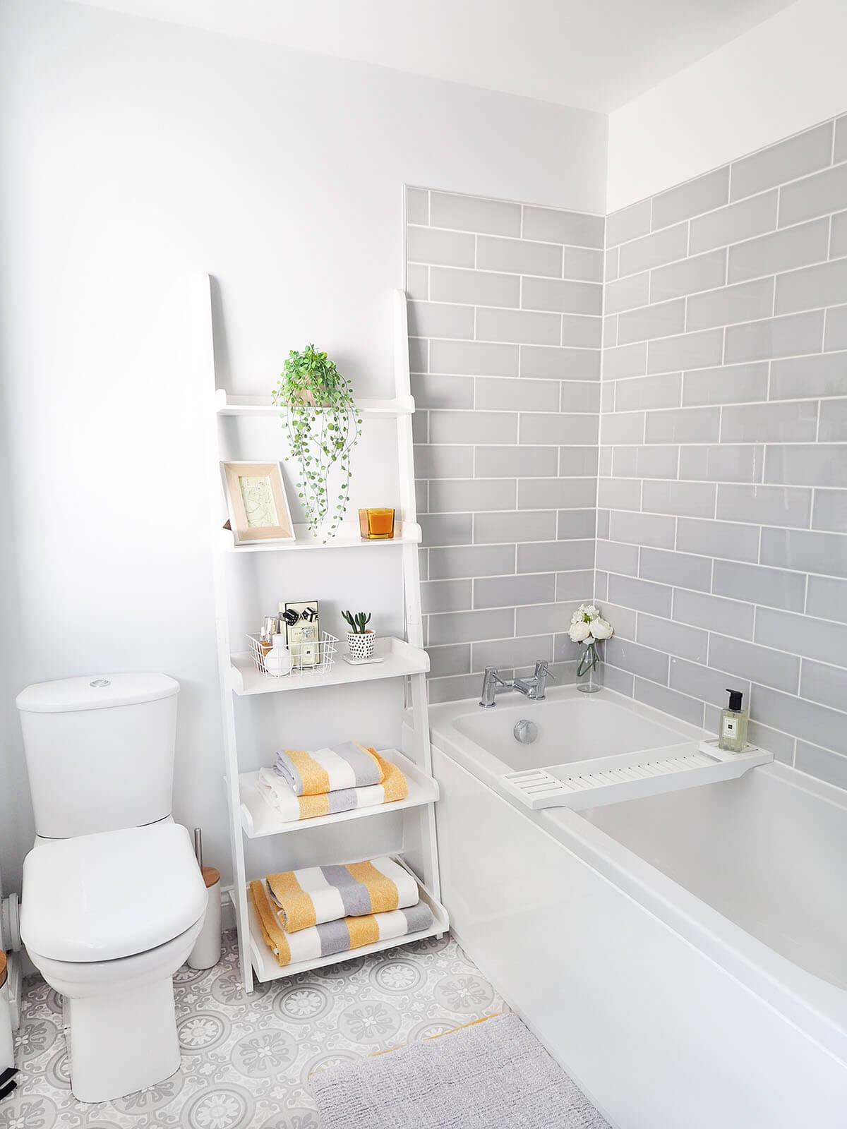 Wide Flat Shelving Between Bathroom Fixtures