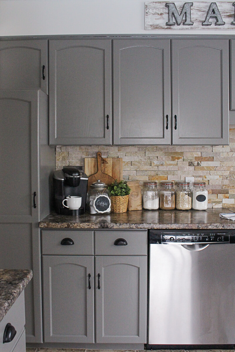 Dramatic Grey Cabinets Complement a Neutral Backsplash