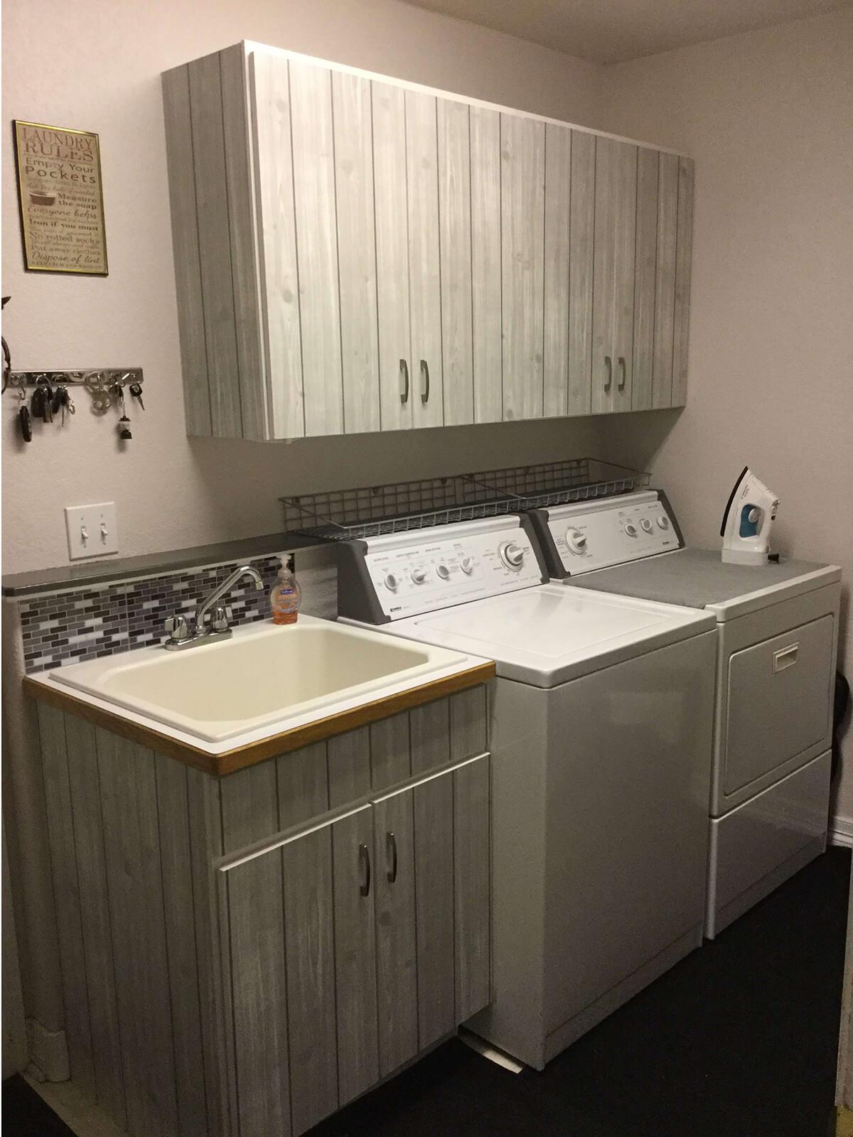 White Washed Grey Laundry Cabinets