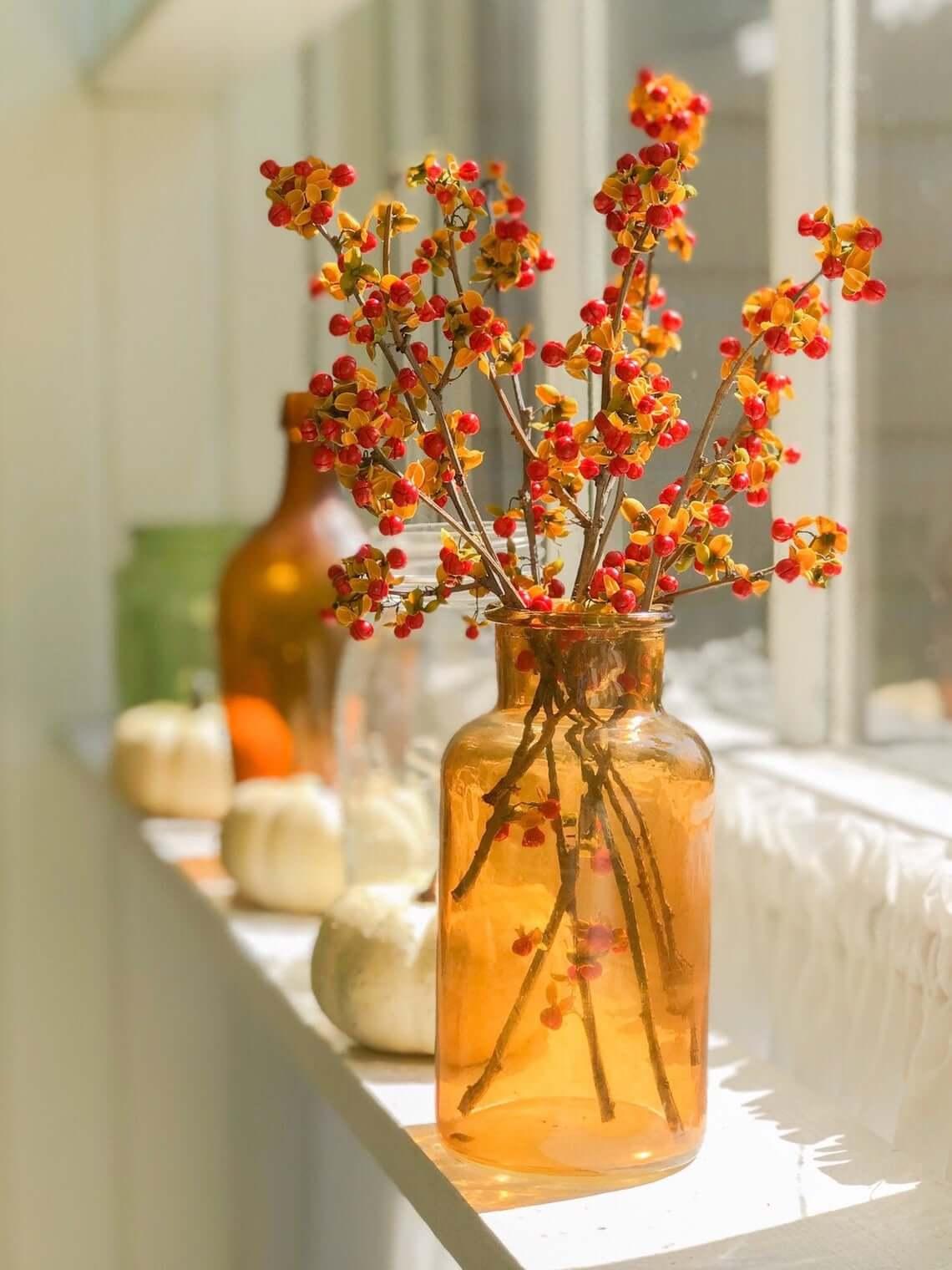 Amber Glass Vase of Fresh Picked Bittersweet