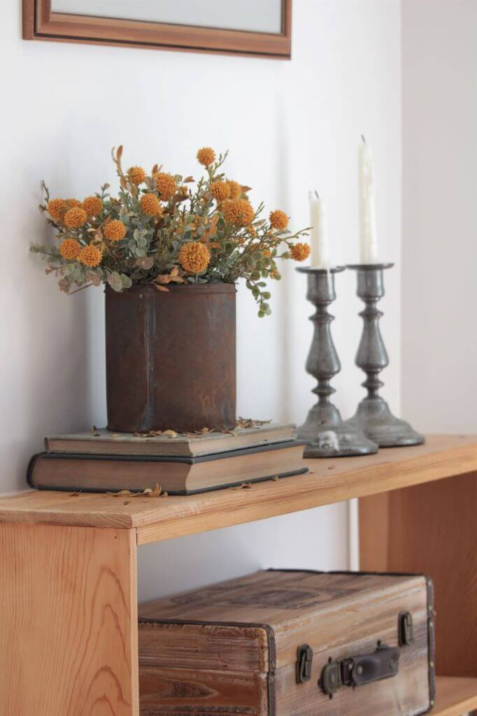 Rusty Urn Filled with Gorgeous Fall Bouquet