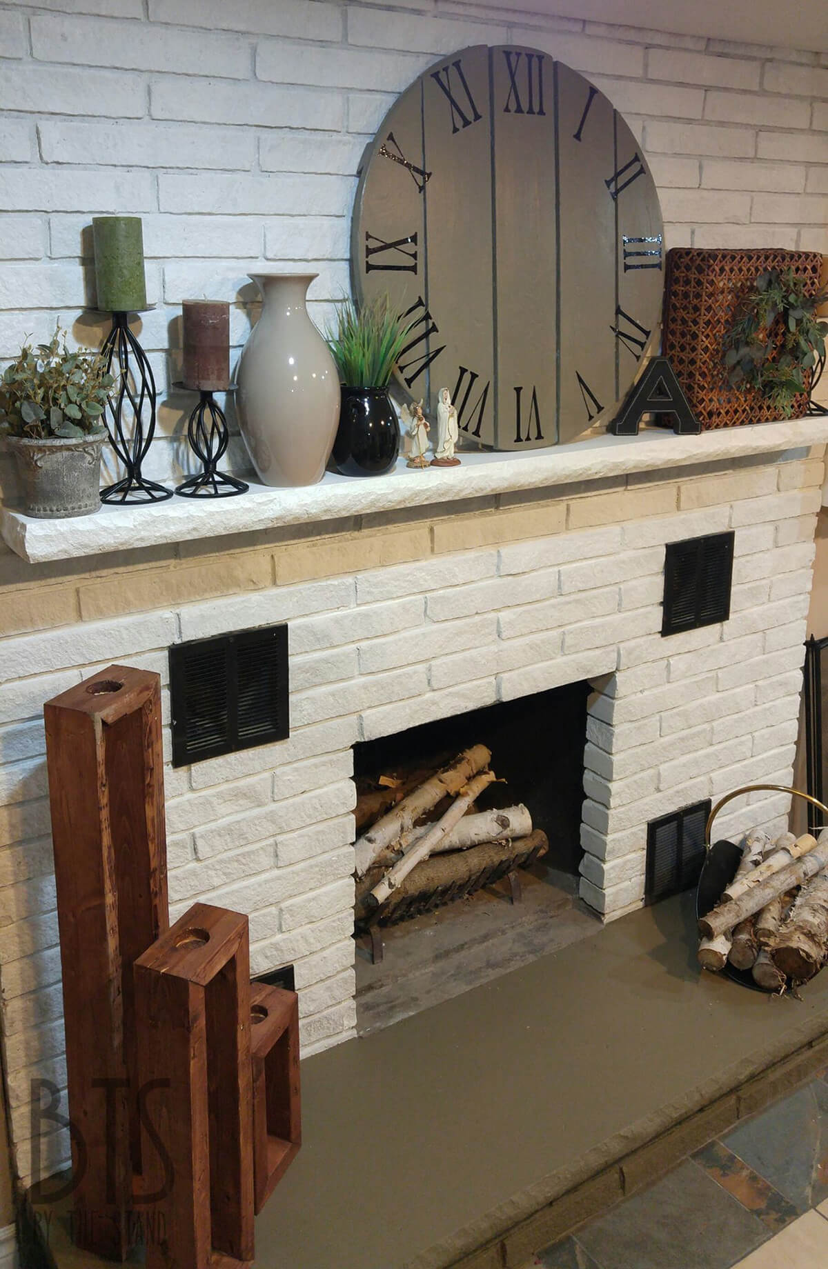 Abundantly Accessorized Mantel on White Fireplace