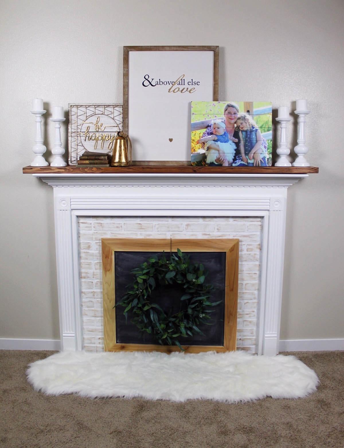 Timeless Whitewashed Brick and Wood Framed Fireplace