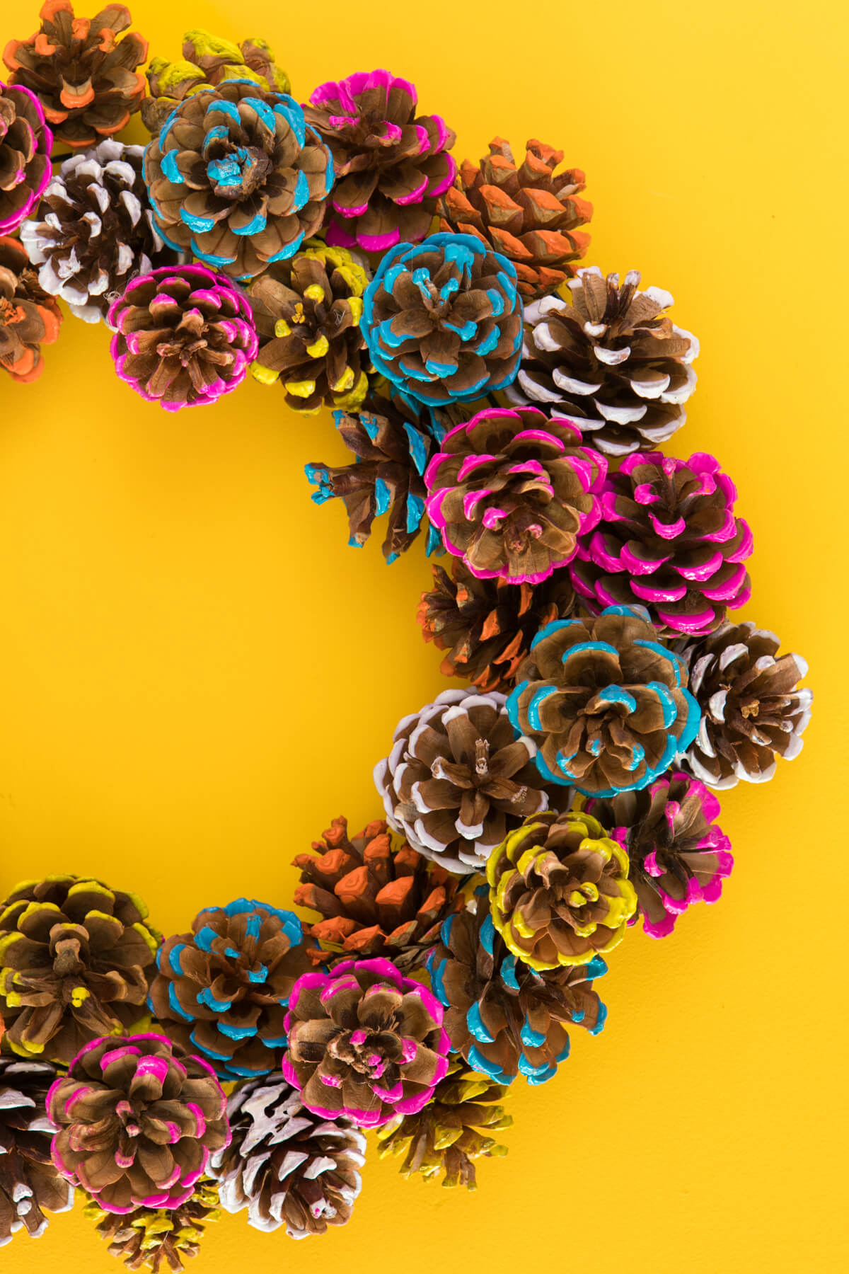 Cheerful Paint-Rolled Pine Cone Wreath