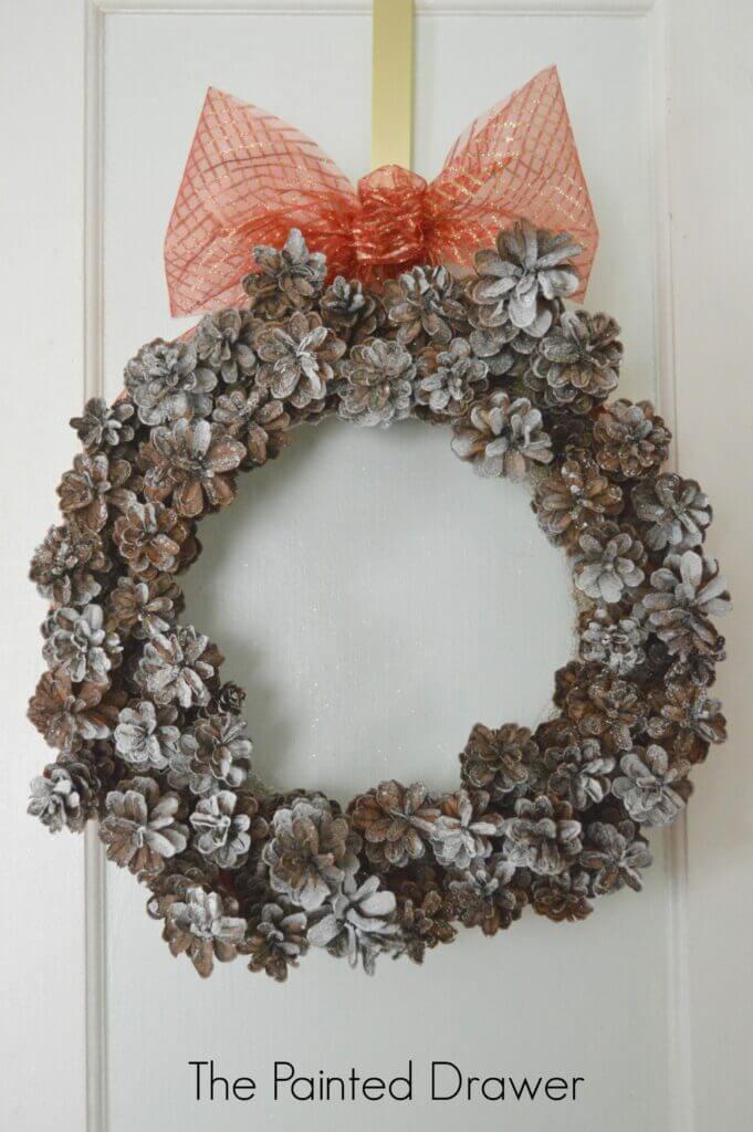 Simple Snow-Tinged Pine Cone Wreath