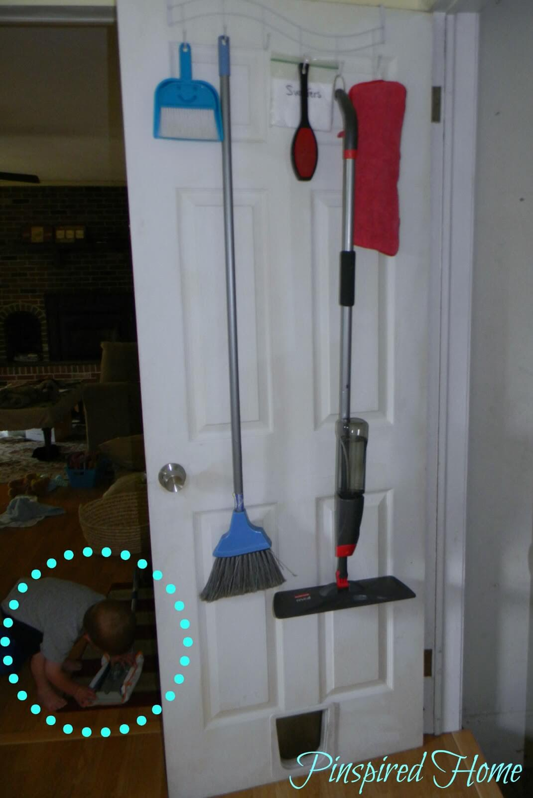 Over-the-Door Coathanger Becomes Cleaning Tool Organizer
