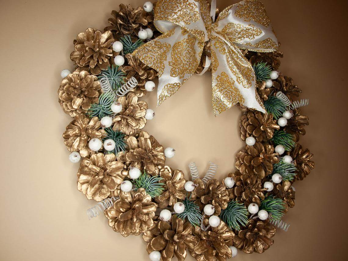 Golden Pine Cone Wreath with a Bow