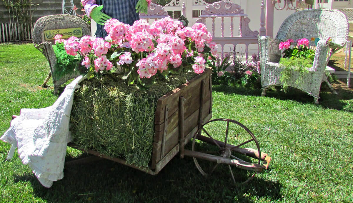 Vintage Hay Wheelbarrow Decorated for Spring