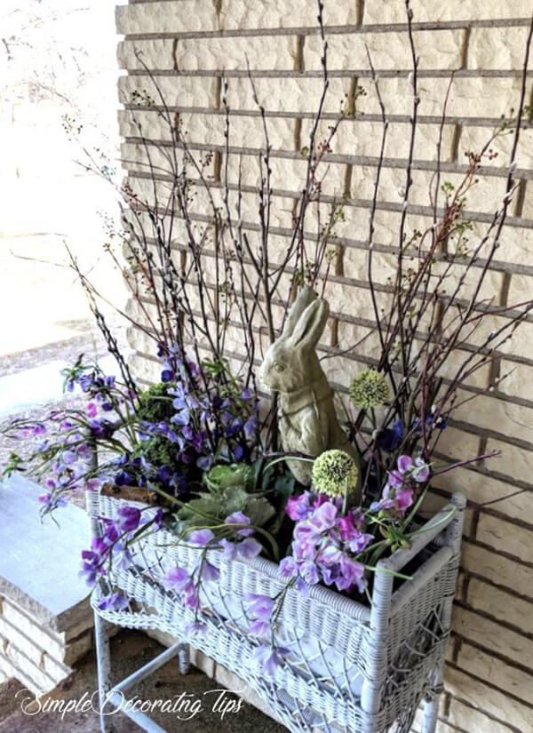 Wicker Planter Stand with Rabbit Statue and Floral Display