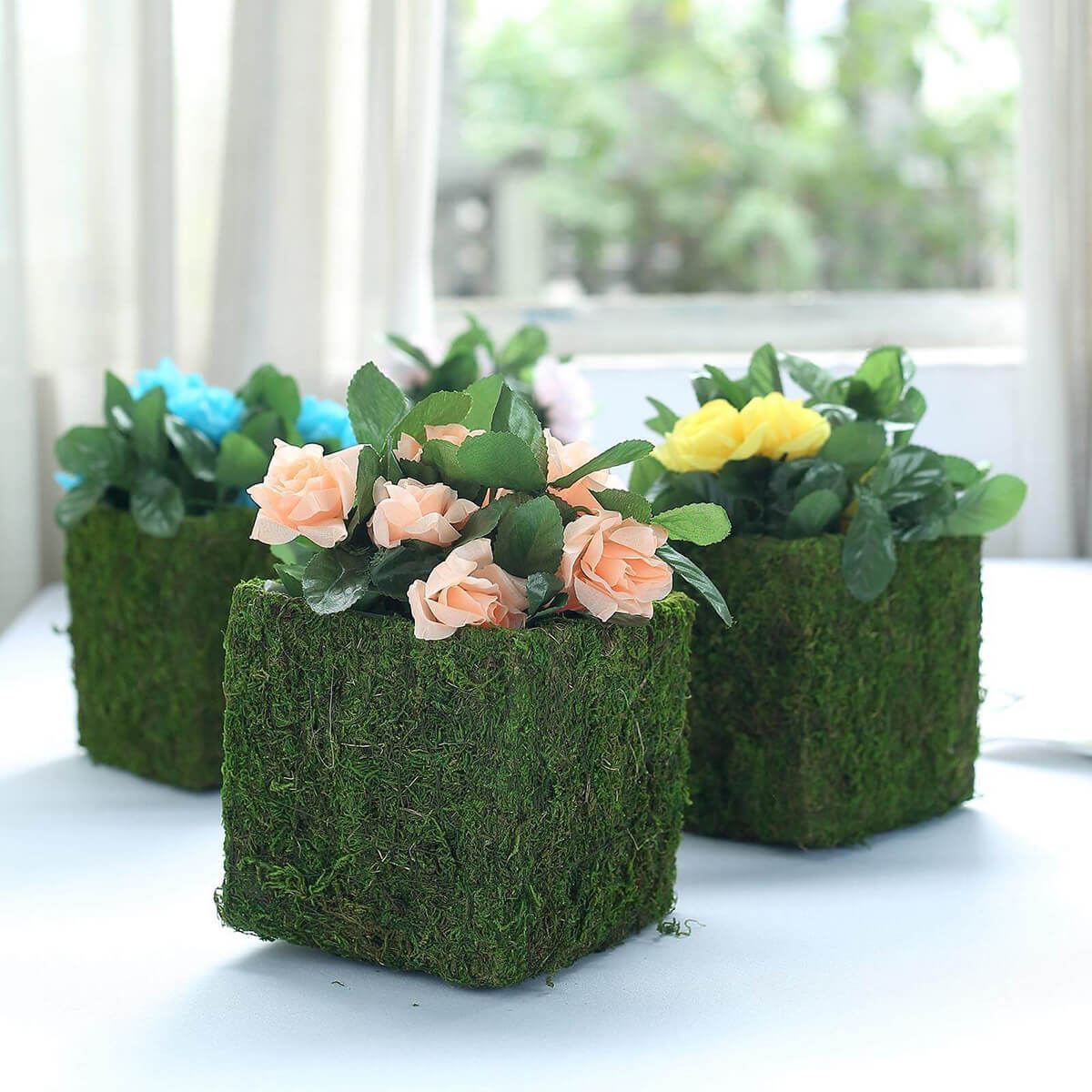 Natural Inspiration With Moss Covered Planters