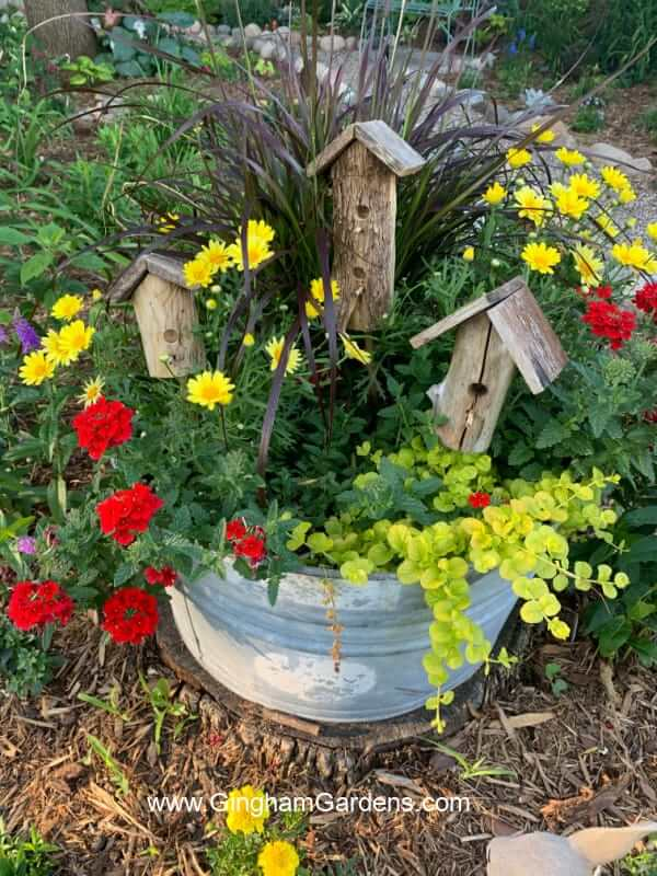 Washtub Planter Bursting with Plants & Faux Birdhouses