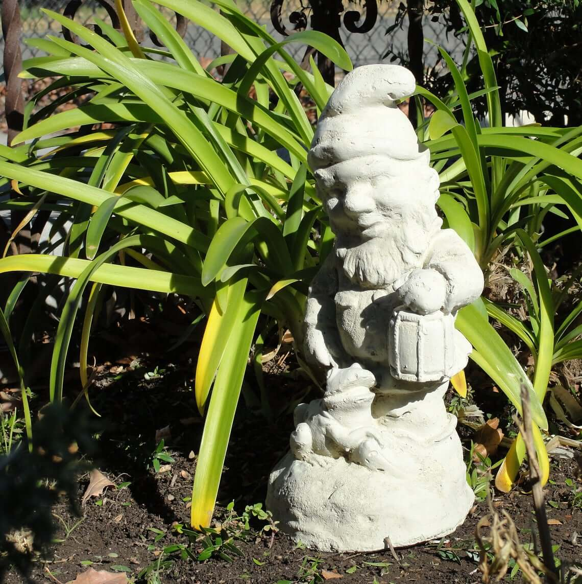 Concrete Garden Gnome Walking a Pet Statue