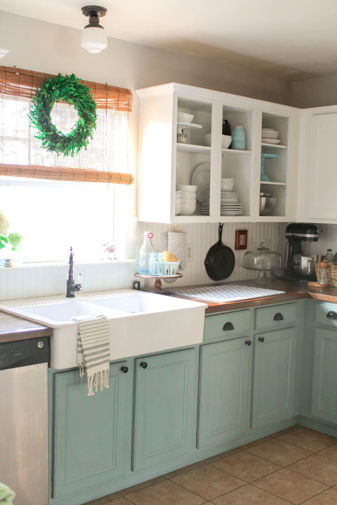 Contrasting Lower Light Blue and Green Cabinets with Traditional Knobs