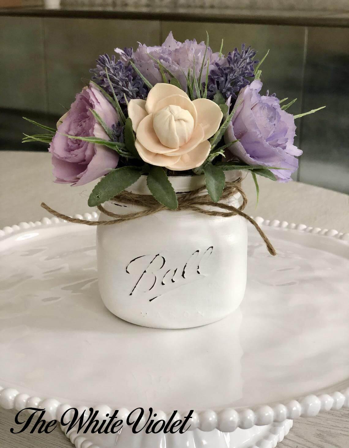 Creamy and Elegant Small Mason Jar Centerpiece