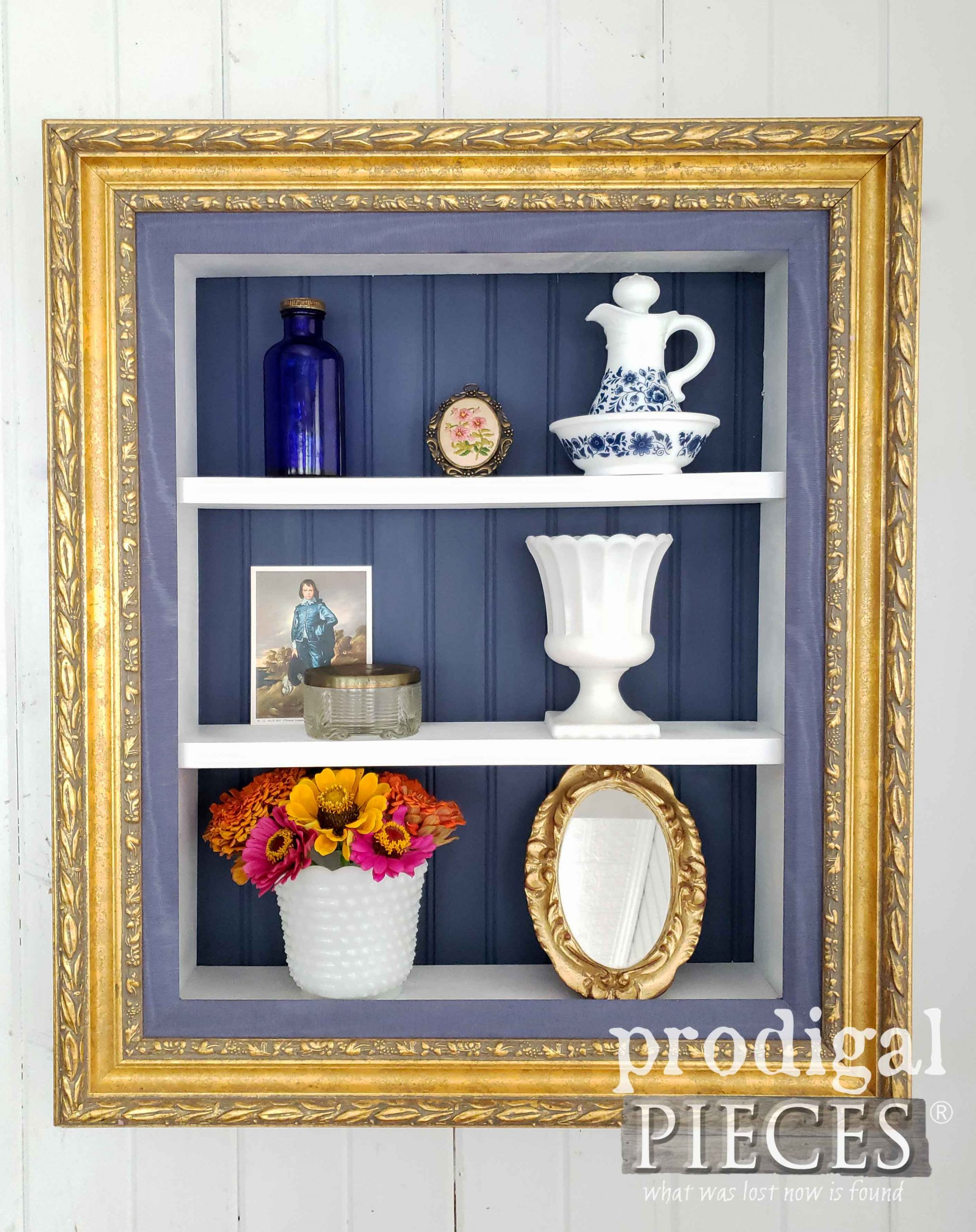 Elegant Gold Frame Shelf for Personal Mementos